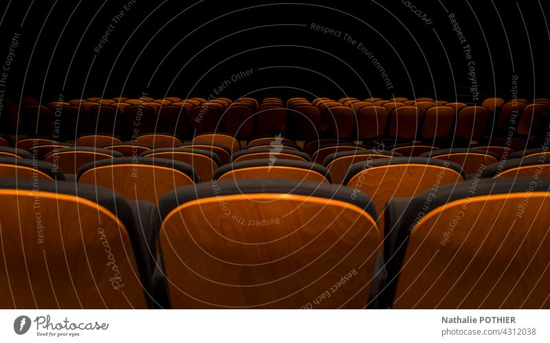 Seats lined up in a performance hall cinema film show seat armchair black Movie hall Leisure and hobbies Cinema Theatre Movie theater seat Dark Empty Armchair