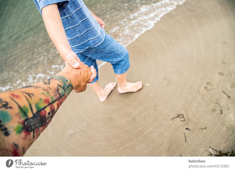 adherence Joy Exterior shot Sand Feet Happiness To hold on Together Happy muck about Family fortunate Emotions proximity in common Trust Contentment Child Son