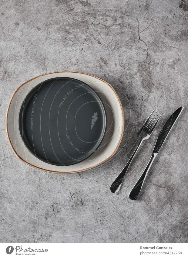 Empty plates, forks on grey concrete background. Top view, concept mockup. spoon studio shot luxury romantic silver dining serving tableware design elegant