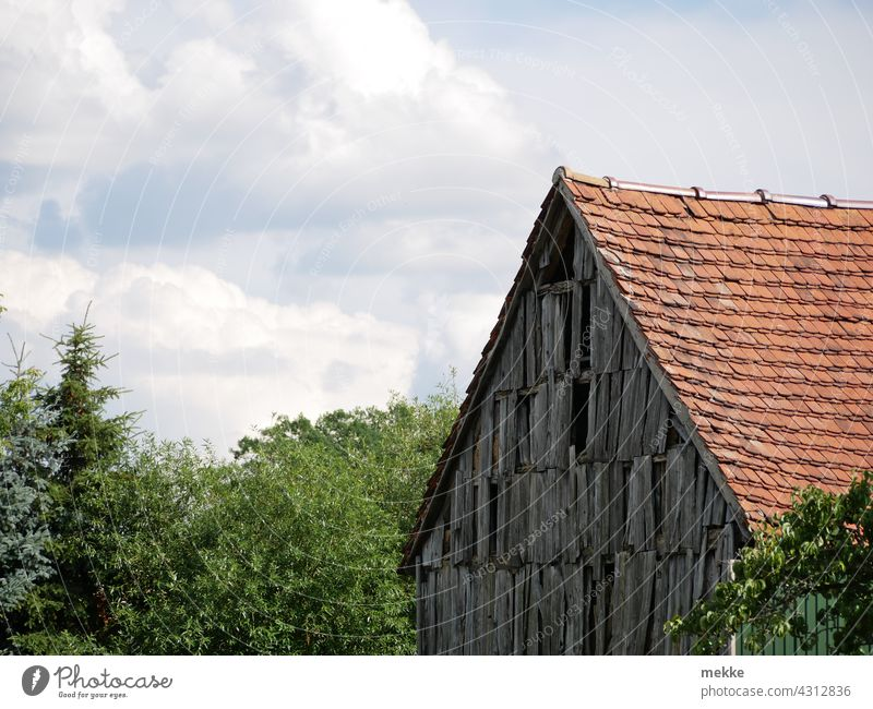 Old rustic wooden facade of a barn in a small village Facade Barn disintegrate Rustic House (Residential Structure) Wood Rural Wall (building) Village Farm