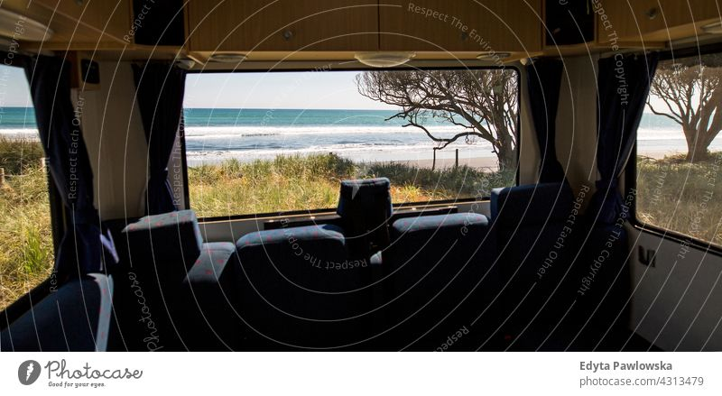 Looking through the window of a camper van rv destination drive journey trip vacations motorhome car transport camping campervan New Zealand daytime oceania