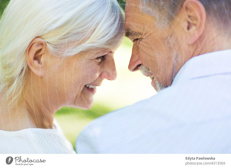 Senior Couple in Love senior seniors couple pensioner pensioners woman casual outdoors adult togetherness two people carefree day Caucasian happiness toothy