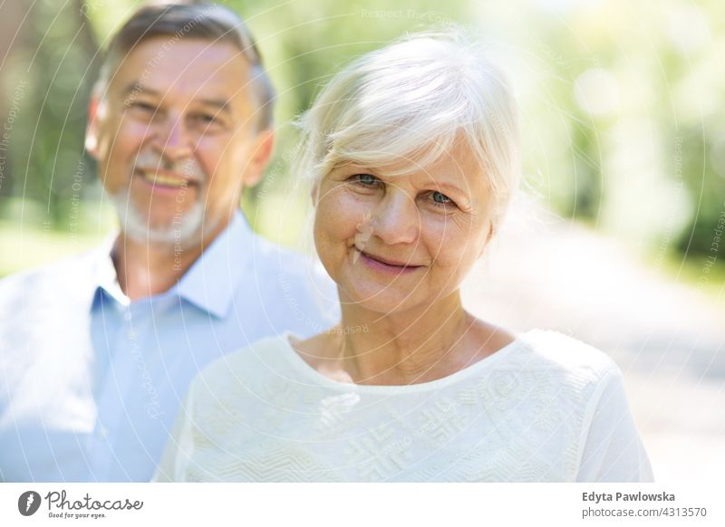 Senior Couple Outdoors senior seniors couple pensioner pensioners woman casual outdoors adult togetherness two people carefree day Caucasian happiness toothy
