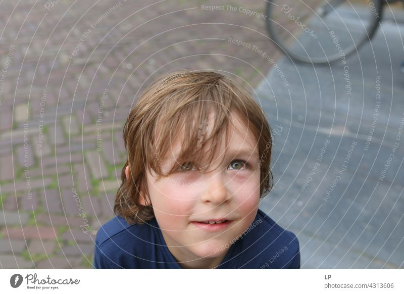 boy with a redish eye looking up at the camera Smiling Trust Accessory Hair and hairstyles Face Dream Dreamily Meditative Looking Authentic Expectation Advice