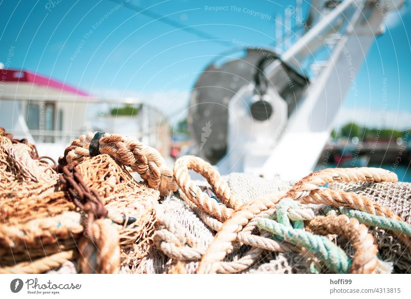 Ropes and rigging on board a fishing boat in bright sunshine ropes Rigging Fishing boat Net Fishing net Fisherman Ocean Fishery Harbour Fishing (Angle)