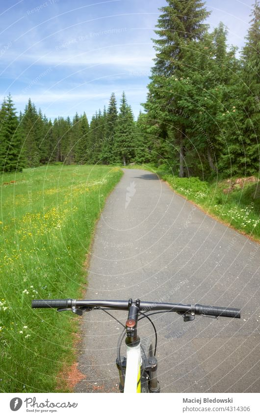 Road in Jizera Mountains, view from above bike steering wheel, Poland. mountains road trip adventure mountain bike Izera sport cycling nature forest landscape
