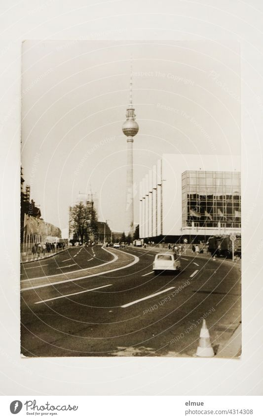 The black and white photo from the 1970s shows the Berlin TV Tower and a part of the Palace of the Republic / GDR architecture / analogue photography
