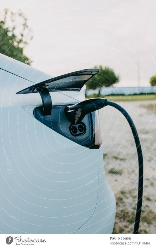 Charging electric car Electricity Energy Electrical equipment Technology Energy industry Connection electricity Cable Environment automobile Car technology