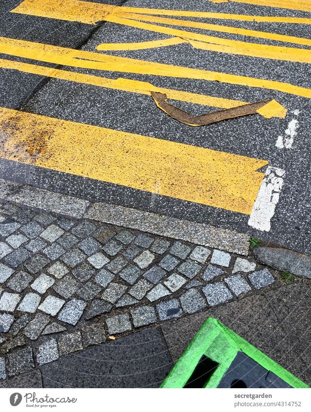 The ravages of time gnaw at glue. mark Street Road traffic Pavement Crossroads Sidewalk Green Yellow Gray Traffic infrastructure Asphalt Lanes & trails