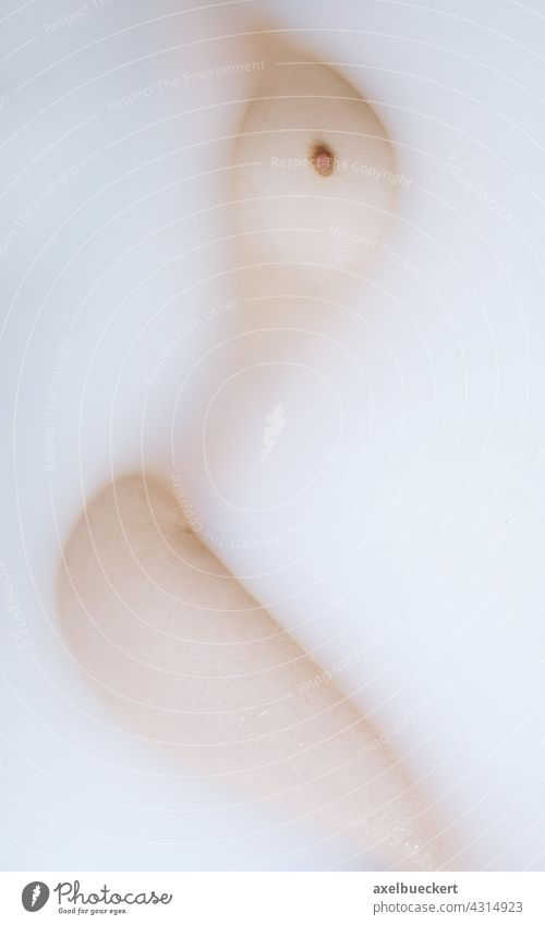 abstract nude with woman body in milk bath Woman's body Female nude Milk bathe Bathtub Abstract Nude photography Naked Feminine Eroticism Breasts Chest Body