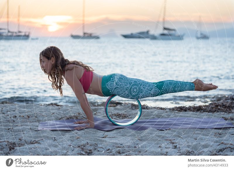 Woman practicing yoga on the beaches of Formentera in Spain balance beautiful beauty body calm energy exercise female fit fitness girl harmony health healthy