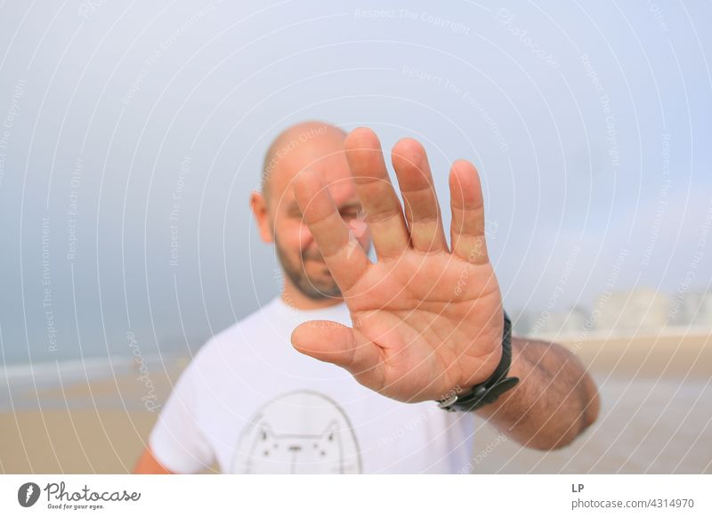 man showing palm at the camera Emotions Tolerant Acceptance Peace solidarity Lovely multiethnic cooperation anti racism two unity interracial