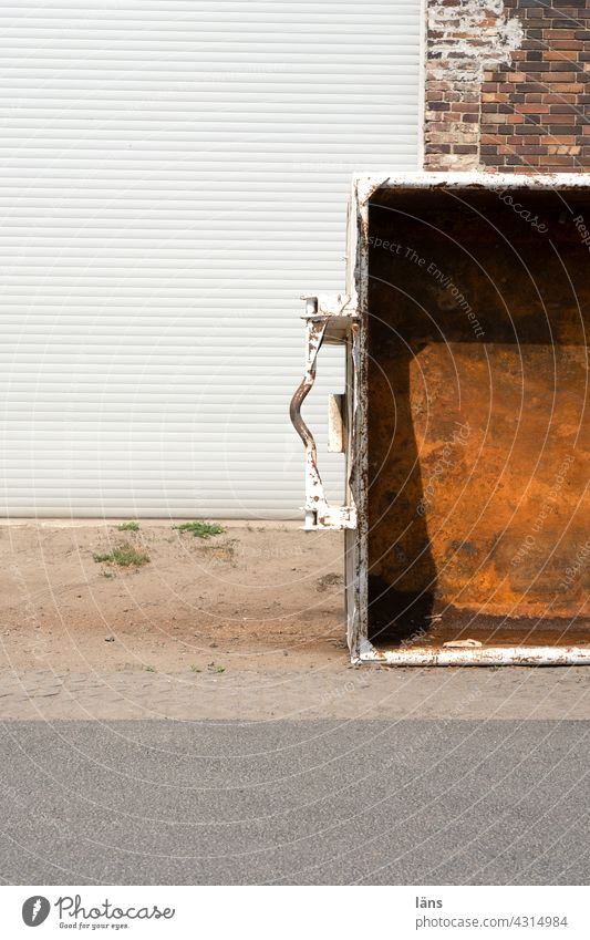 Lost Land Love l Dumpster waste containers Edgewise Industrial zone rusty Rolling door Industry Deserted Warehouse Industrial plant Factory hall