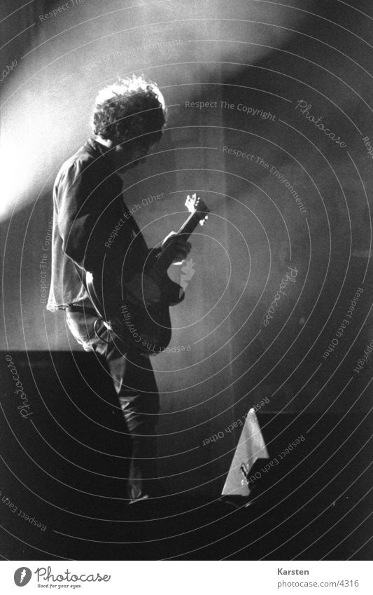 guitarist Light Radiation Guitarist Stage Concert Human being Rock music Music Black & white photo
