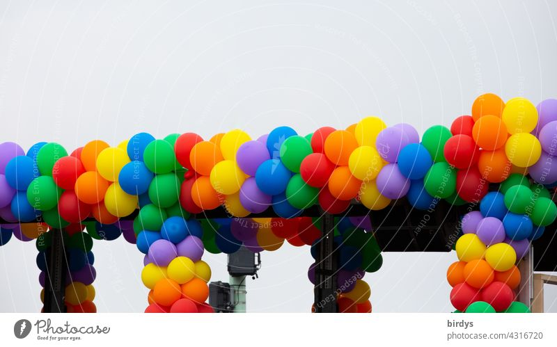 Many balloons joined together to rainbow colors. Symbol for freedom, respect, homosexuality and gender justice. Prismatic colors variegated Homosexual queer