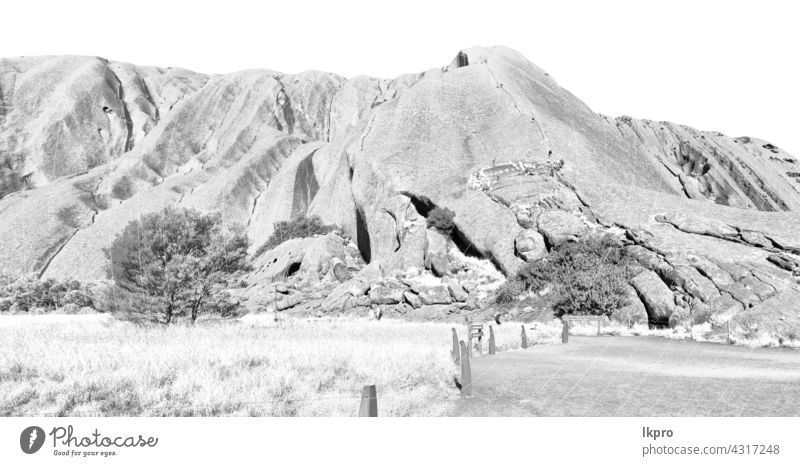 AUSTRALIA,AYERS ROCK-CIRCA  AUGUST 2017-unidentified people walking on the sacred mountain australia uluru park national rock landscape tjuta desert hiking kata