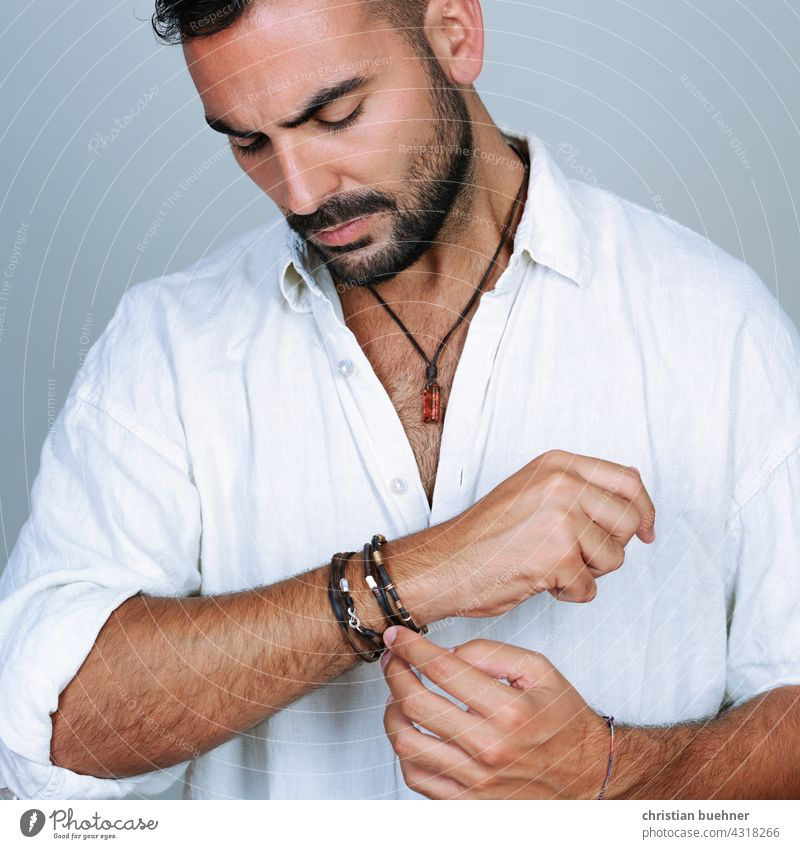portrait of a young man with arm and neck jewellery Man studio Jewellery necklace Necklace Amber stones fashion Fashion arm jewellery Bracelets Bangle