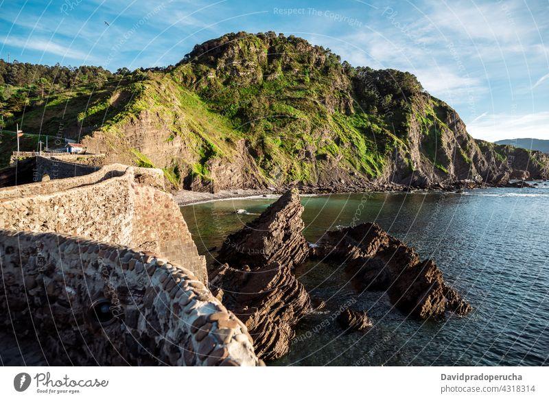 Road to rocky island in sea path scenery pathway wall destination breathtaking san juan de gaztelugatxe vizcaya pais vasco spain nature sunny sunlight idyllic