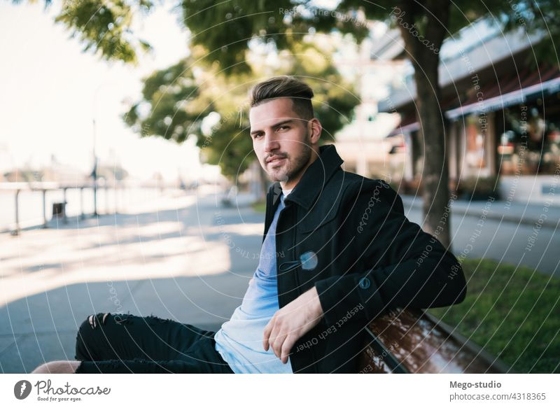 Portrait of young man. adult alone attractive background boy casual caucasian cheerful city clothing confident cool exterior face fashionable friendly handsome