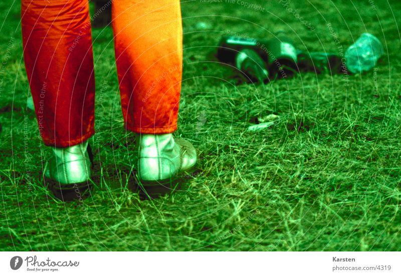 fairground Footwear Meadow Trash Green Human being Feet Orange Music festival Feasts & Celebrations
