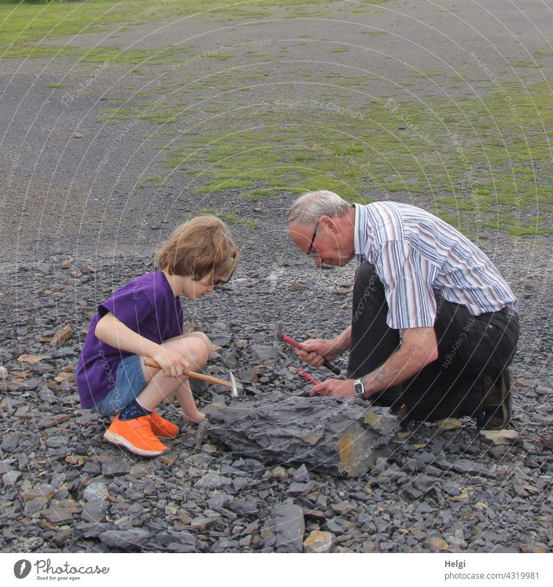 in search of fossils - grandpa and grandson search for fossils in the Piesberg quarry near Osnabrück Fossil Fossil Search Grandfather Human being Man Child