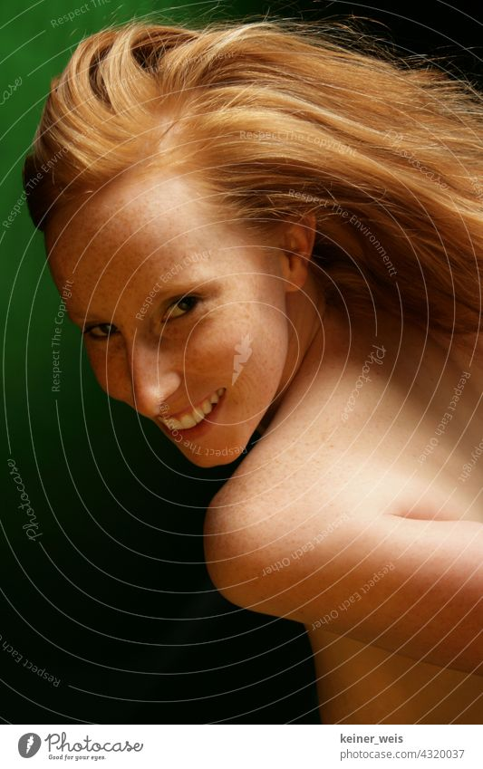 Redhead woman shows skin with freckles and smiles at the camera Woman Red-haired portrait Naked Skin Feminine Hair and hairstyles Freckles Green Laughter