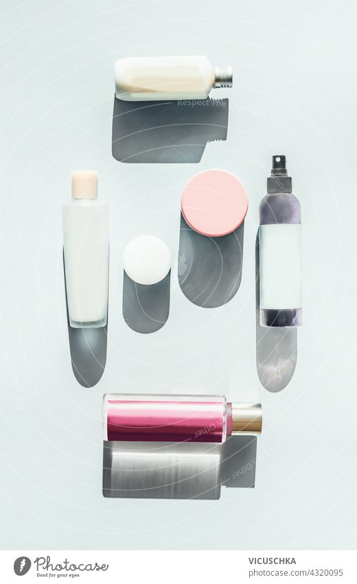 Set of cosmetics for skin care. Lots of cosmetic products, bottles and jars on a light background in sunlight. Top view. Beauty flat lay. Mock up branding set