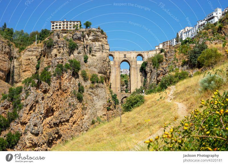 Beautiful view of historic roman bridge in Ronda, Spain ronda andalusia spain summer beautiful medieval arches sevilla countryside cityscape urban sightseeing