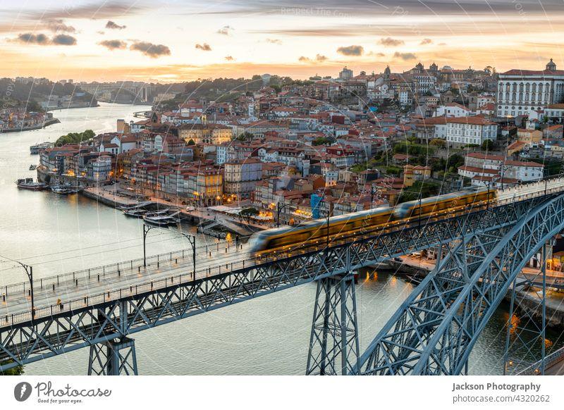 Skyline of the historic city of Porto with bridge by sunset, Portugal porto portugal ribeira night lights illuminated twilight sky nighttime beautiful