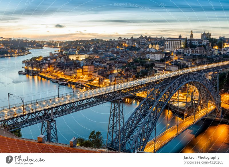 Skyline of the historic city of Porto with famous bridge at night, Portugal porto portugal light illuminated architecture attraction beautiful boats building