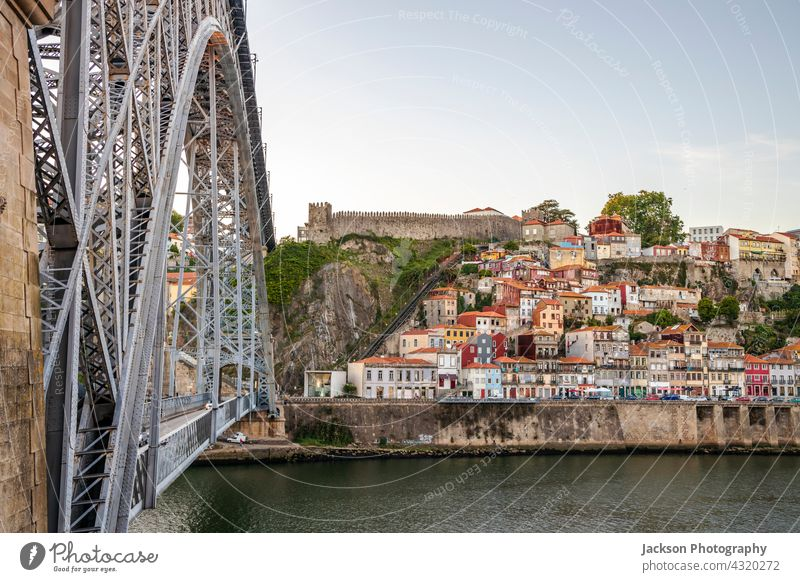 Cityscape of the historic city of Porto with famous bridge, Portugal porto sunset portugal skyline cityscape illuminated architecture attraction beautiful boats