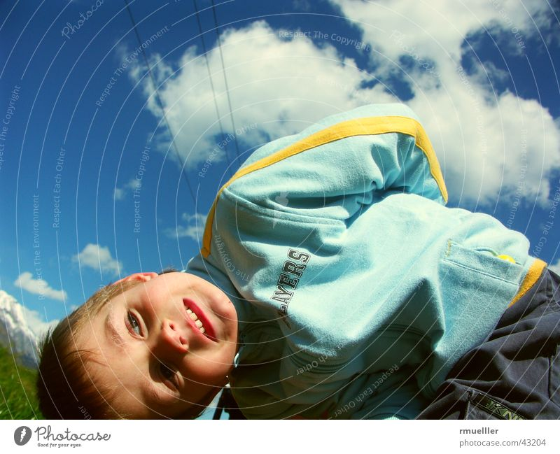 The sky above me Child Clouds Gymnastics Hiking Portrait photograph Leisure and hobbies Small Human being Joy Playing Sky fun Nature Funny Laughter