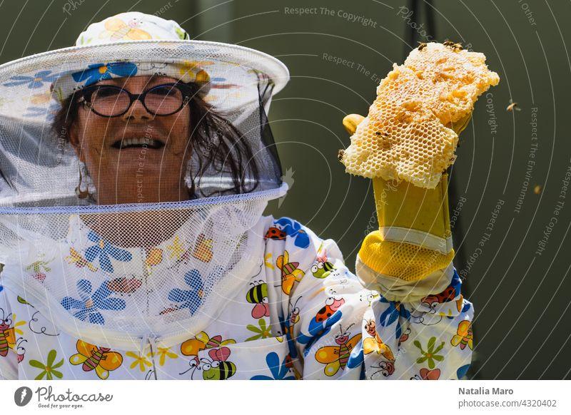 Beekeeper Beekeeper holding honey comb woman frame food summer nature spring beekeeper honeycomb hive farm people beekeeping apiarist agriculture apiary