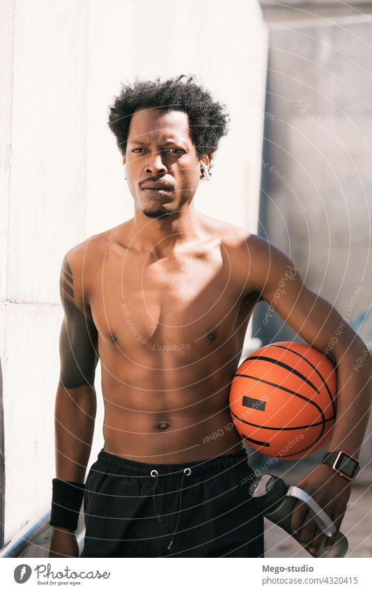 Afro athlete man holding a basketball ball outdoors. sport urban athletic standing enjoy expression active hand exercise recreation sports fitness sportive