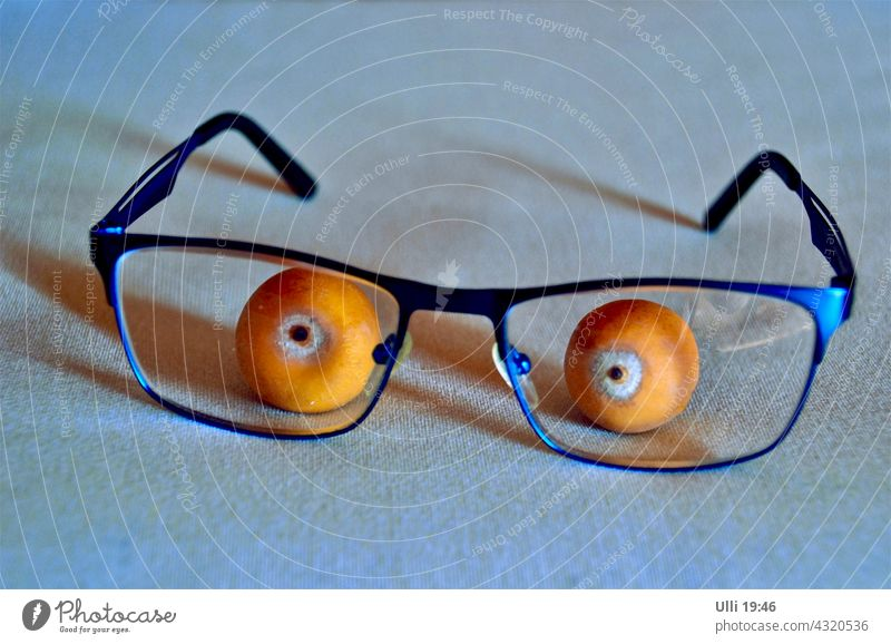 Palm fruit with reading glasses. Table decoration Eyeglasses Reading glasses Palm tree Palm Fruit tablecloth funny action amusing idea eyes blue glasses Orange