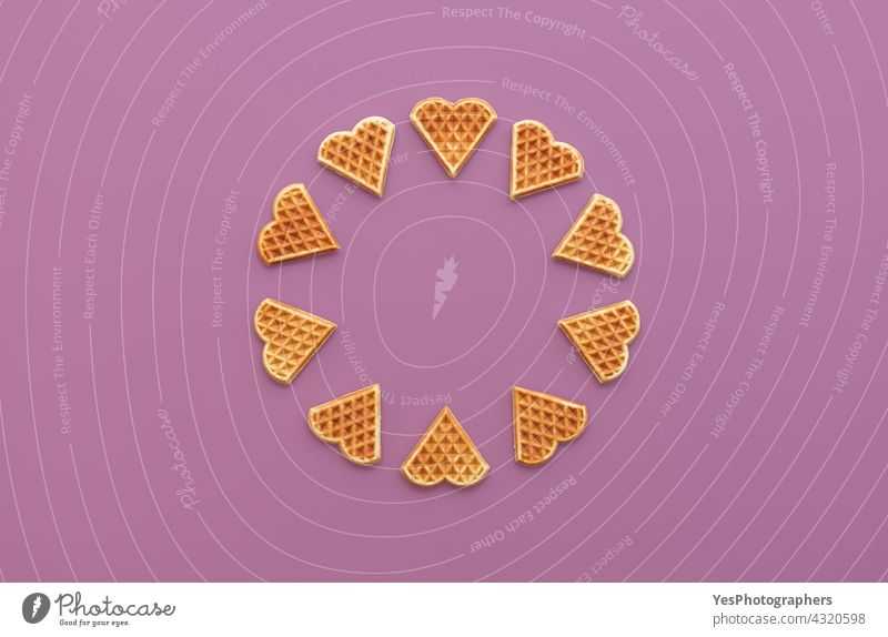 Heart shaped waffles top view on a purple background above aligned arranged baked bakery belgian belgium breakfast circle color copy space cuisine cut out day