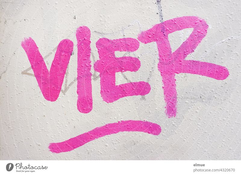 FOUR is written in pink on the grey wall / graffito four 4 Graffito Graffiti spray Colour Pink Printed letters Street art Daub Wall (building) Creativity
