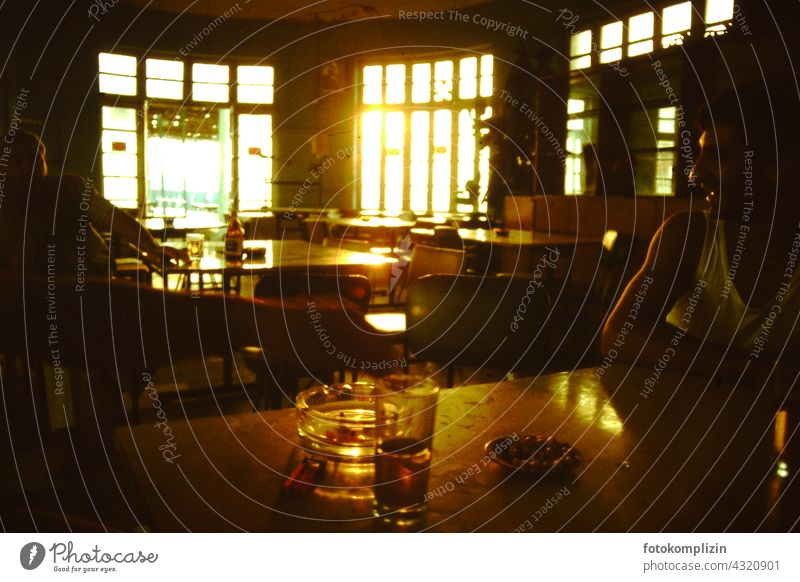 Sunlight through high windows on a table in an old cafe Café Bar Restaurant Pub Closing time Table Sidewalk café Saloon Man guests Guest chairs Tourism Window