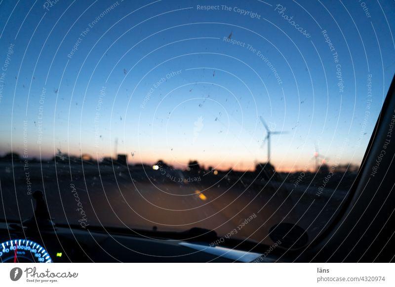 Blue hour drive Car journey blue hour Twilight Evening Sunset Light Colour photo Pinwheel speedometer Windscreen