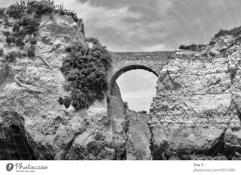 an old stone bridge on the Atlantic coast in Portugal Bridge b/w Black & white photo Architecture Exterior shot Day Deserted Old building Manmade structures