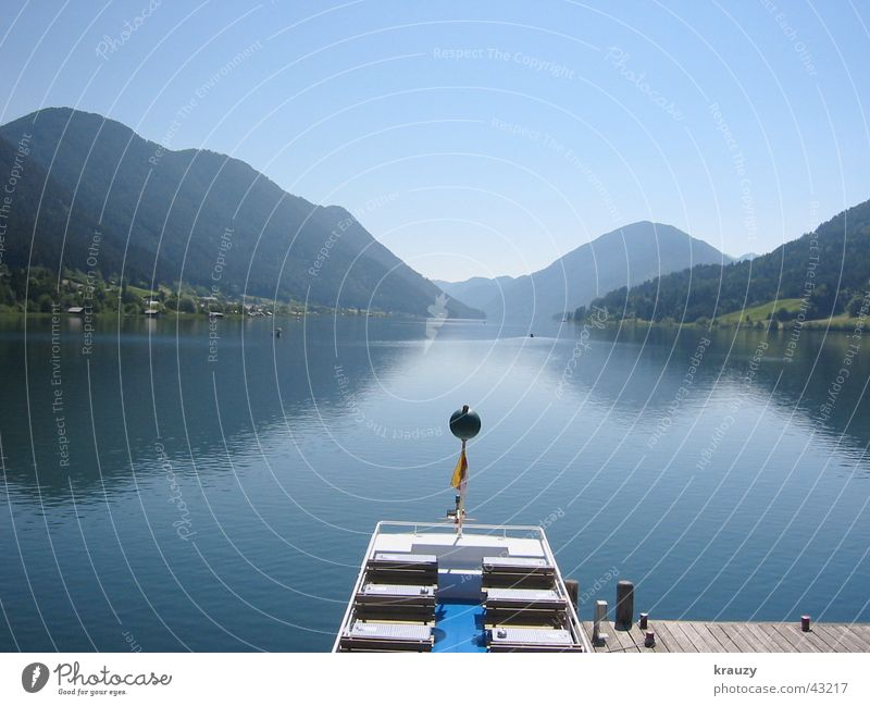 mountain lake Lake Footbridge Austria Lake Weißensee Surface Midday Calm Mirror Reflection Mountain Smoothness Water Alps