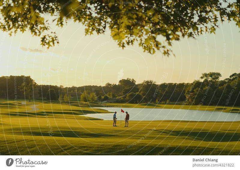 Sunset Time On The Golf Course Golf course Friendship friend talk Golfer Playing Green Exterior shot Dawn golden golden hour Sunrise joy enjoy fun friends tiny
