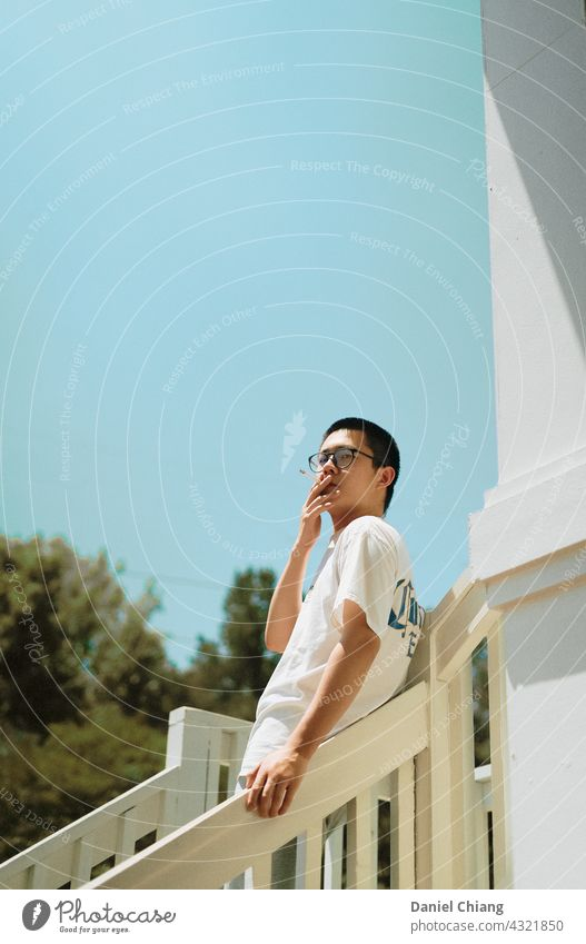 Guy Smoking Smoke Cigarette smoke Man guy mood mad moody moment Lifestyle Face asian Smoky young teen boy standing angry Exterior shot outside Stairs