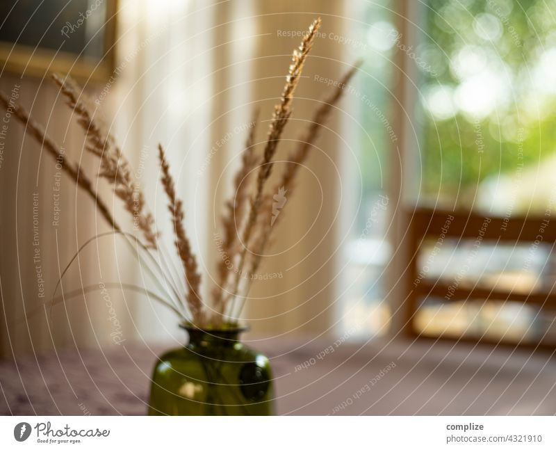 Dried grass in the vase dry grass Vase Decoration ornamental grasses Flat (apartment) naturally Living room Table Dinner table Chair Style home