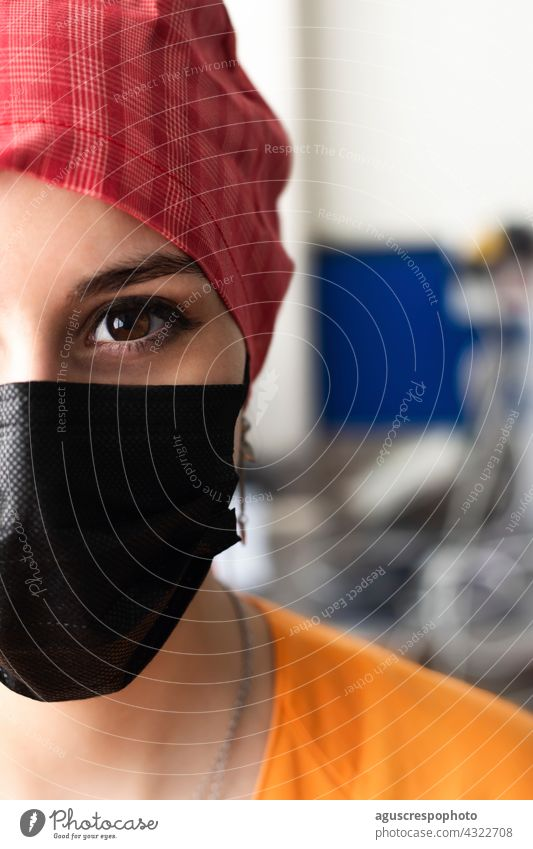 Face of a young doctor prepared to enter the operating room eye face portrait nurse mask surgical mask cap surgical cap pupil hospital operation room uniform