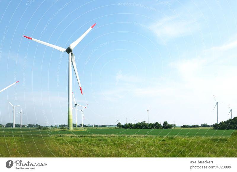 Wind turbines in the North German Plain Pinwheel wind farm wind power Wind energy plant Renewable energy Energy industry Electricity Environmental protection