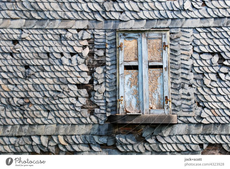 Shutter closed with crooked wobbly roof tiles Roofing tile House (Residential Structure) Architecture Structures and shapes pitched roof Background picture