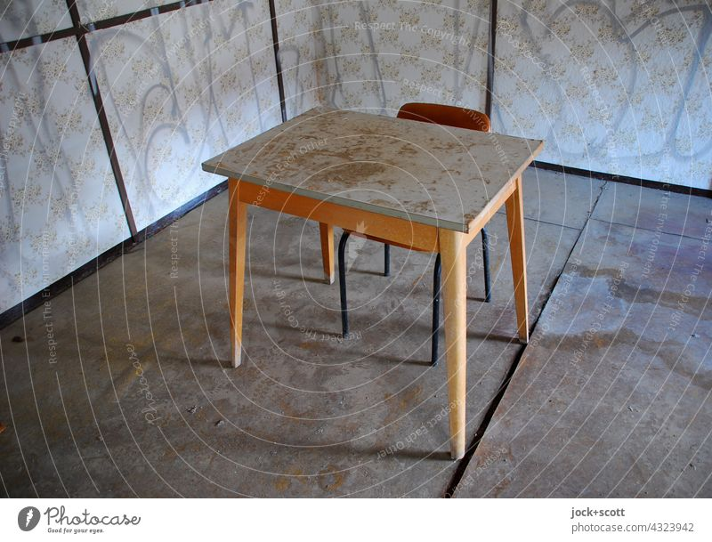 bent room with table + chair Room sample wallpaper Wooden table Chair slanting Undulating frowzy lost places Interior design Ravages of time Decline Change