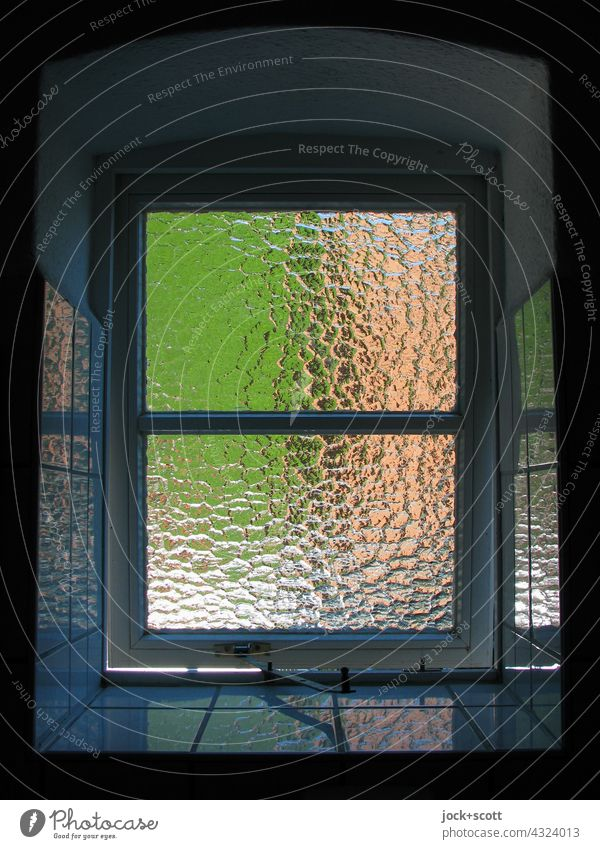 Window with ribbed glass pane windowsill Window reveal corrugated Glass Window pane Reflection tiles Architecture Sunlight transparent Surface structure