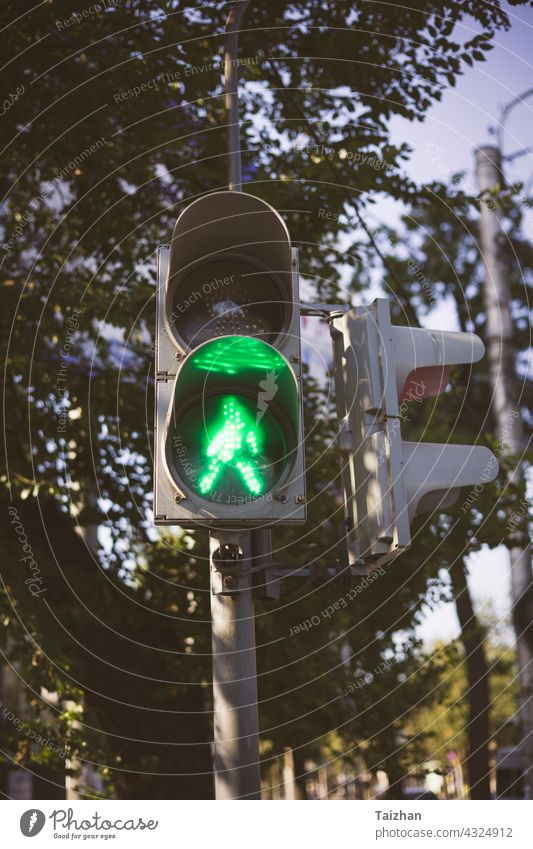 traffic light with green arrow light up in city . close up stoplight control lamp signal go urban color road symbol street direction driving headlight image law